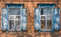 Two windows with wooden shutters in an old ukrainian country house Royalty Free Stock Photo