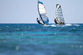 Two windsurfers in action Stock Photo
