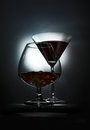 Two wineglass with the alcohol on dark background Stock Photography