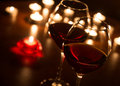 Two wineglasses lit by candlelight Royalty Free Stock Photography