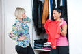 Two woman friends choosing clothes women choose in front of closet Royalty Free Stock Images