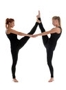 Two woman gymnast in black stand on split Stock Photography