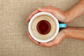 Two woman hands holding empty black coffee cup Royalty Free Stock Photo