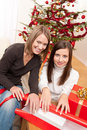 Two woman packing Christmas present Royalty Free Stock Photos