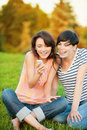 Two woman read SMS Royalty Free Stock Photography