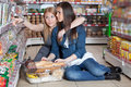 Two woman  in supermarket Royalty Free Stock Photos