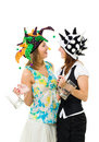Two woman talking in jester hats Royalty Free Stock Photography