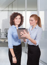 Two woman using tablet women in office Stock Photos