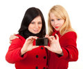 Two women in autumn coats with camera Royalty Free Stock Images
