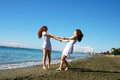Two women on beach in limassol cyprus Stock Images