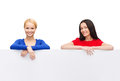 Two women with big blank white board advertisement and happy people concept smiling Royalty Free Stock Photo