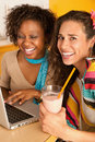 Two Women at Cafe Using Laptop Stock Photography
