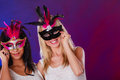 Two women with carnival venetian masks Royalty Free Stock Photo