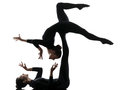 Two women contortionist exercising gymnastic yoga silhouette practicing in on white background Stock Photos