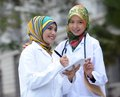 Two women doctor scarf Royalty Free Stock Photo