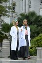 Two women doctor scarf Stock Photos