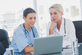 Two women doctors working on a laptop Royalty Free Stock Photo