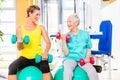 Two Women Doing Strength Sport...