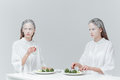 Two women eating at the table Royalty Free Stock Photo