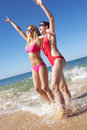 Two Women Enjoying Beach Holiday Royalty Free Stock Image