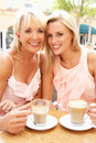 Two Women Enjoying Cup Of Coffee Royalty Free Stock Photos