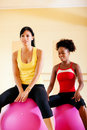 Two women with fitness ball in gym Royalty Free Stock Images