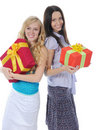 Two women with gifts. Royalty Free Stock Images