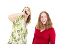 Two women having fun while singing Royalty Free Stock Photos