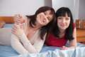image photo : Two   women having fun on sofa