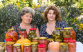 Two women and home canned vegetables a Royalty Free Stock Images