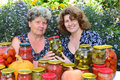 Two women and home canned vegetables a Royalty Free Stock Photo