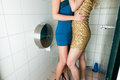 Two women kissing in the toilet Stock Images