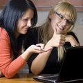 Two women on laptop Royalty Free Stock Photos