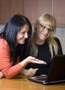 Two women on laptop Royalty Free Stock Image