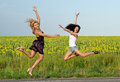 Two women leaping for joy Royalty Free Stock Photography