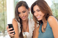 Two Women Looking At Mobile Phone Royalty Free Stock Images