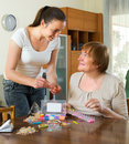 Two women make bracelets at home Royalty Free Stock Photo