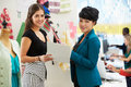 Two Women Meeting In Fashion Design Studio Stock Photo