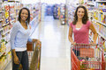 Two women meeting in supermarket Stock Photo