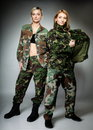 Two women in military clothes army girls full length on gray background Royalty Free Stock Photo
