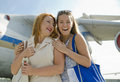 Two women mother and daughter met at the airport after trip a about aircraft Royalty Free Stock Images