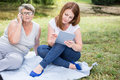Two women and new technology Royalty Free Stock Photo
