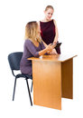 Two women at the office working at his desk on the Internet. Royalty Free Stock Photo