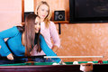 Two women playing pool Stock Images
