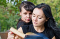 Two women reading a book together Royalty Free Stock Photos