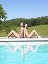 stock image of  Two Women Relaxing By Pool