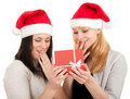 Two women in Santa hat keeping red box Stock Image