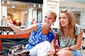 Two women in a shopping center Stock Photo