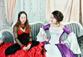 Two women sisters in medieval dresses Stock Images