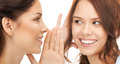 Two women spreading gossip bright picture of woman Stock Photos
